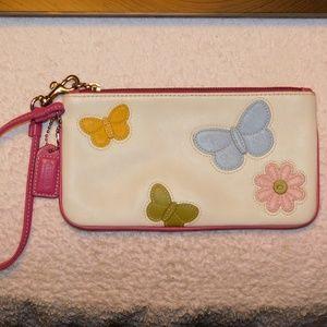 Coach applique buterflys and flowers wristlet